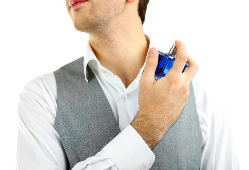 Man applying cologne