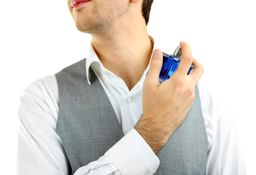 Man applying cologne