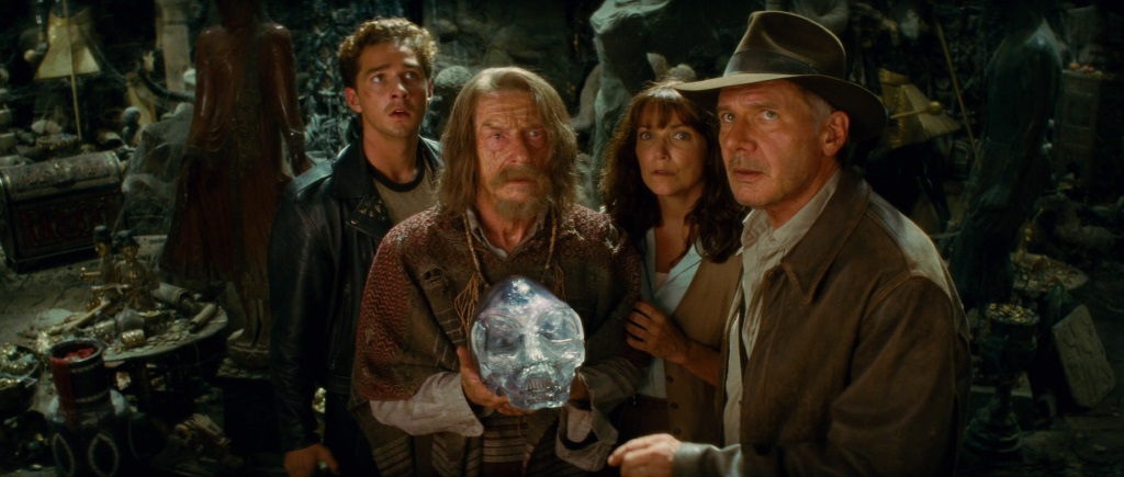The cast of Indiana Jones and Kingdom of the Crystal Skull standing together and holding the skull