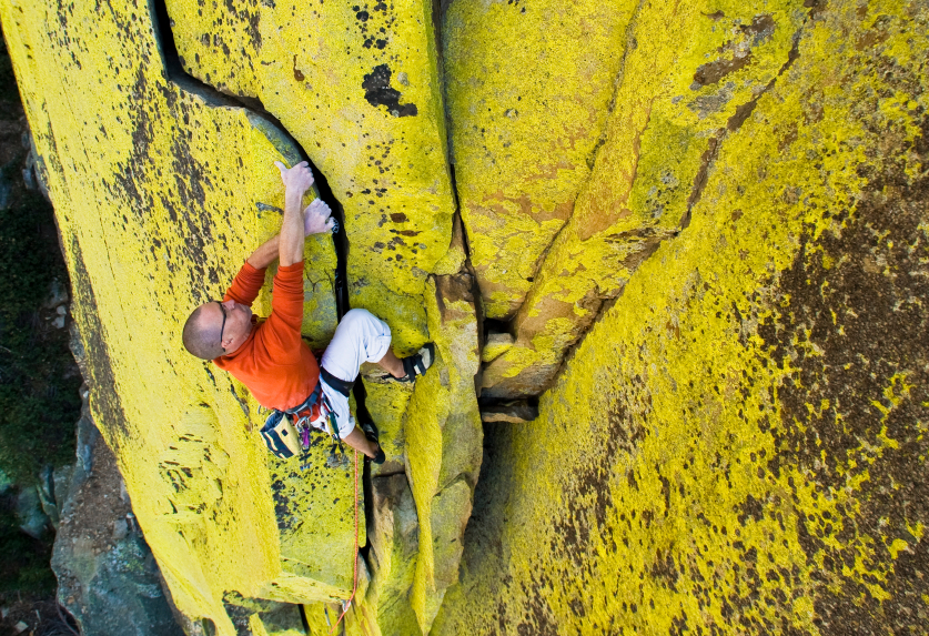 A man scaling a rock face