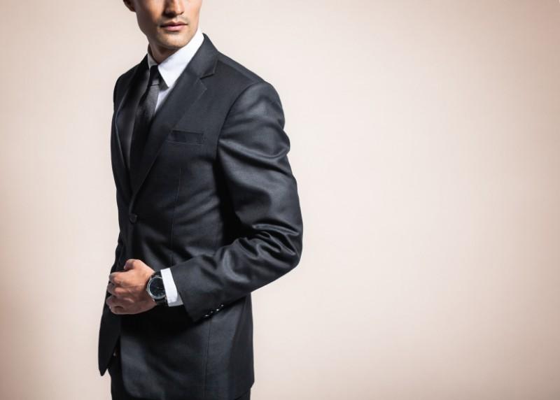 man wearing tailored suit