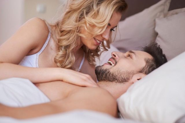 a couple talking in bed