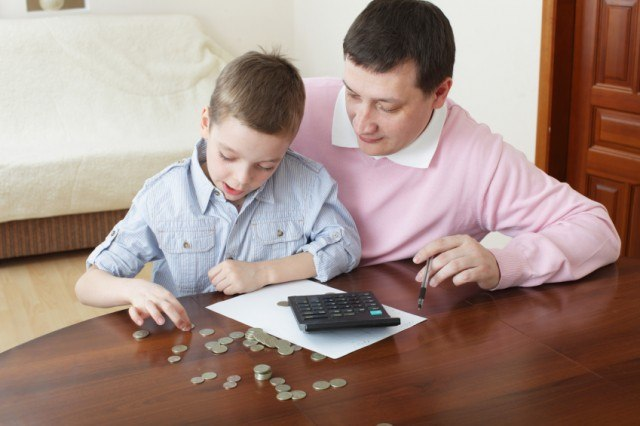 Father counting money with son