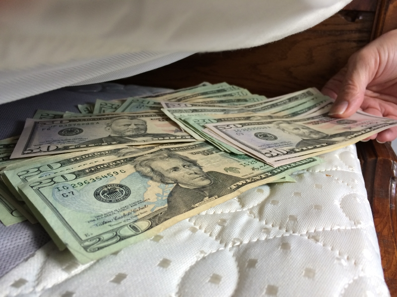 Money is hidden under a mattress