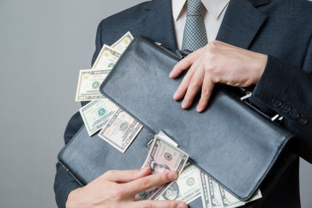 Man holding brief case with money, salary