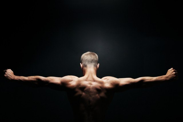 Man showing his back muscles