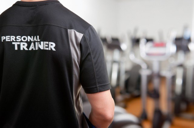Man wearing a personal trainer shirt