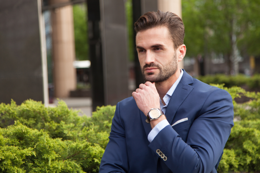 man wearing watch and suit