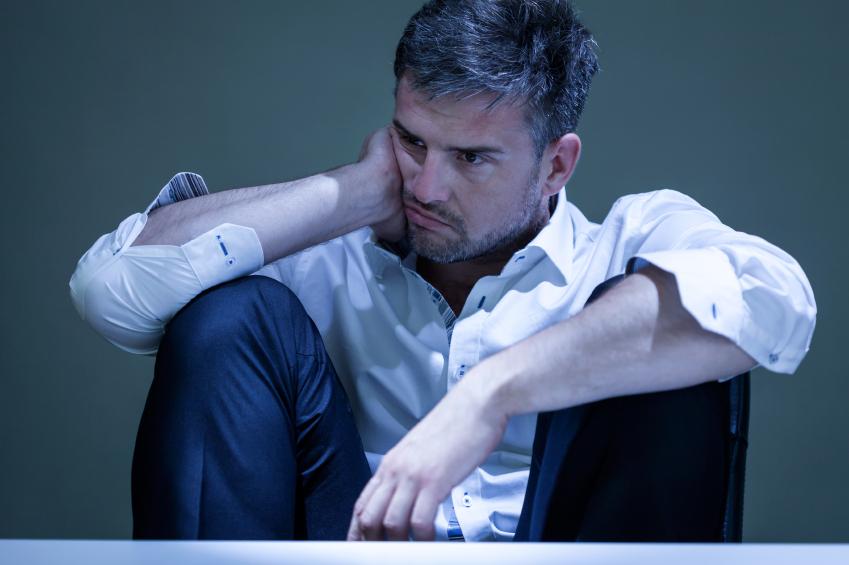 Man worrying as he sits