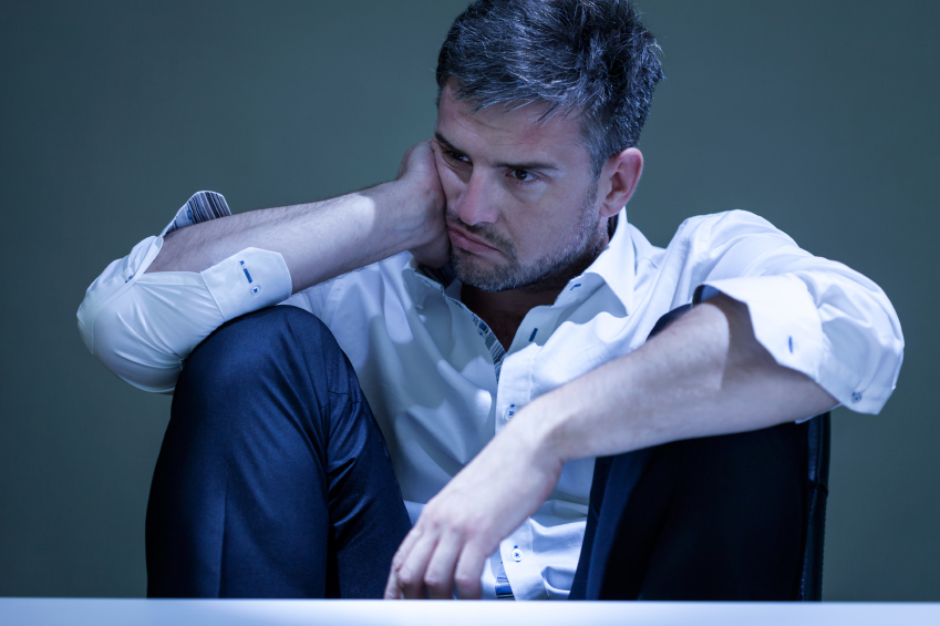 a depressed man thinking