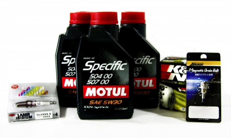 A typical automobile tune up includes everything pictured here, plus a fresh air filter