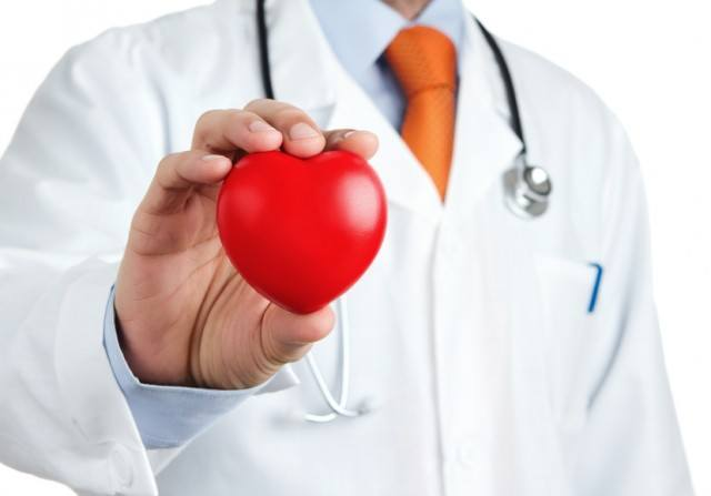 doctor in a white coat holding a heart-shaped ball