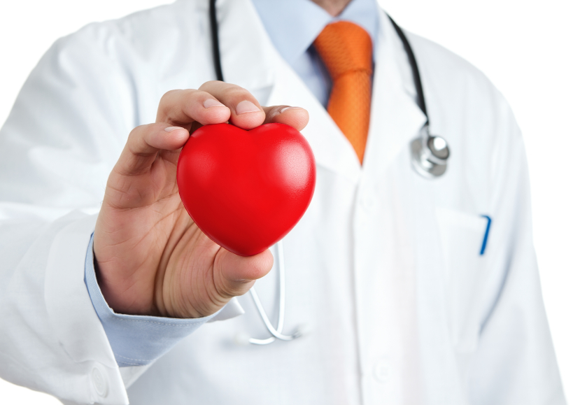 doctor in a white coat holding a symbol to indicate heart health