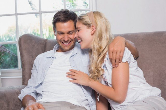 couple, cuddling, sofa, laughing