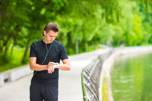 Man setting timer for workout