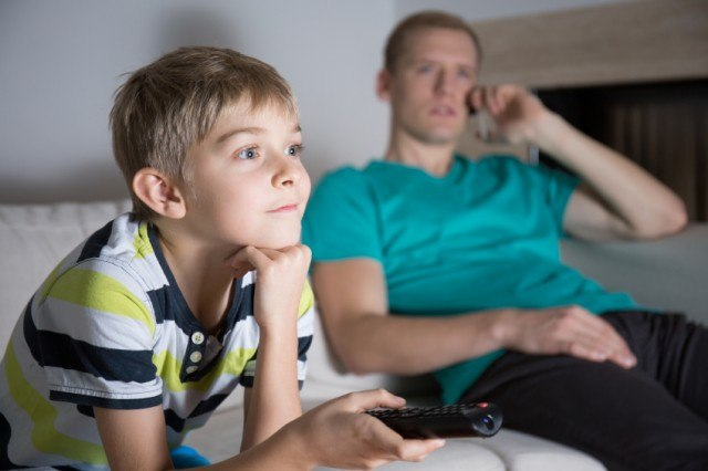 A father and son watching TV