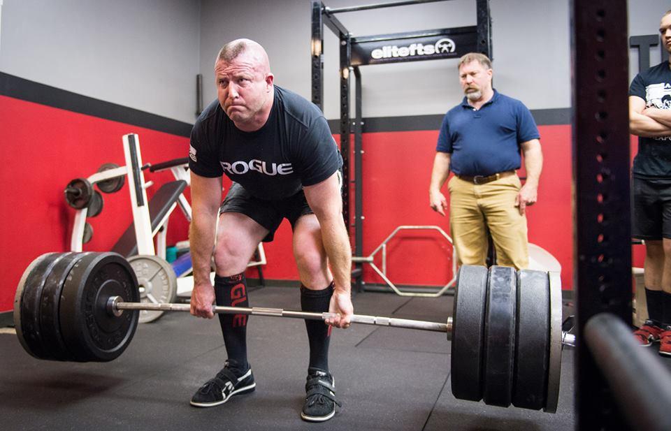 a man lifting weights