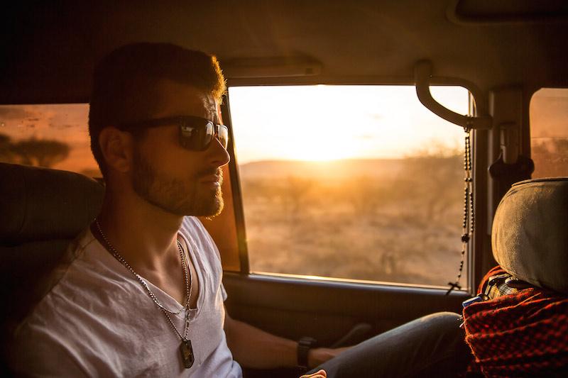 a man sitting in a car, thinking