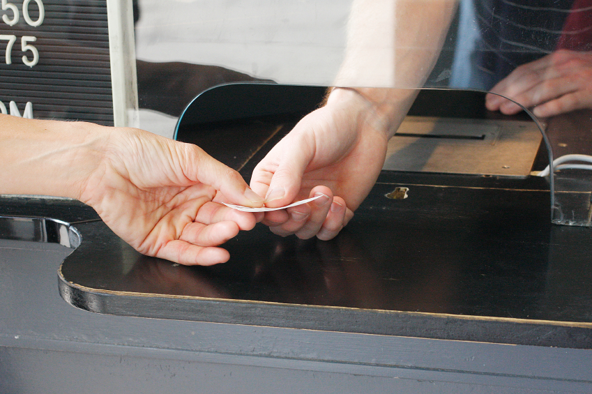 A man buying a ticket for transportation