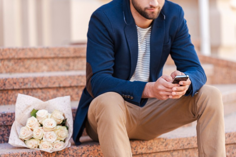 a well-dressed man waiting for his date
