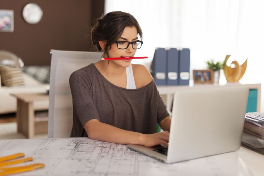 woman doing work at desk