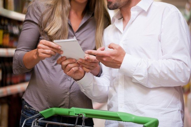 young couple looking at a grocery list