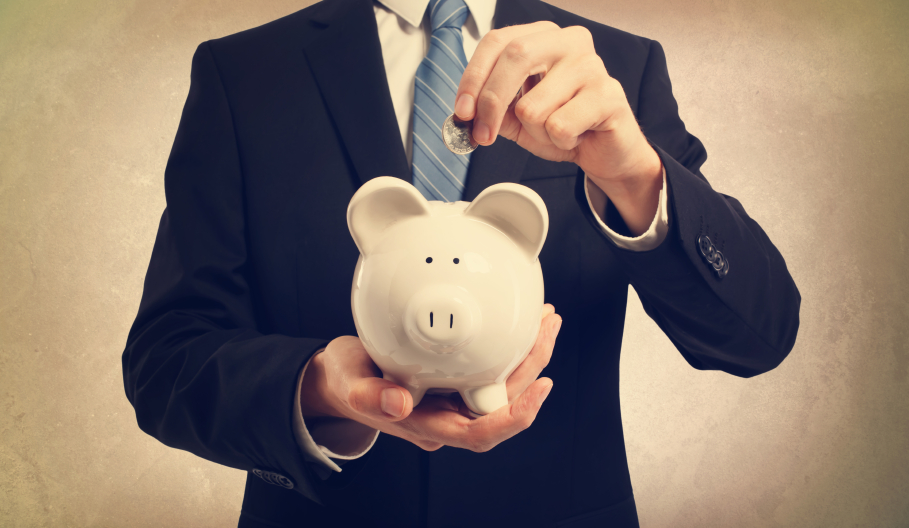 man saving money in piggy bank