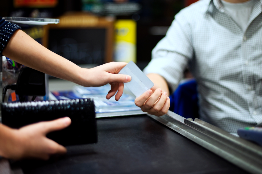 A customer hands over a credit card