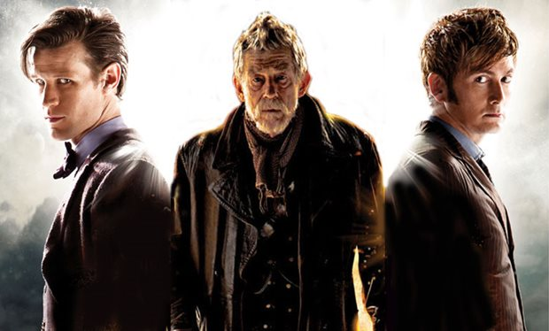 Three characters from 'Doctor Who' pose together and look straight ahead.