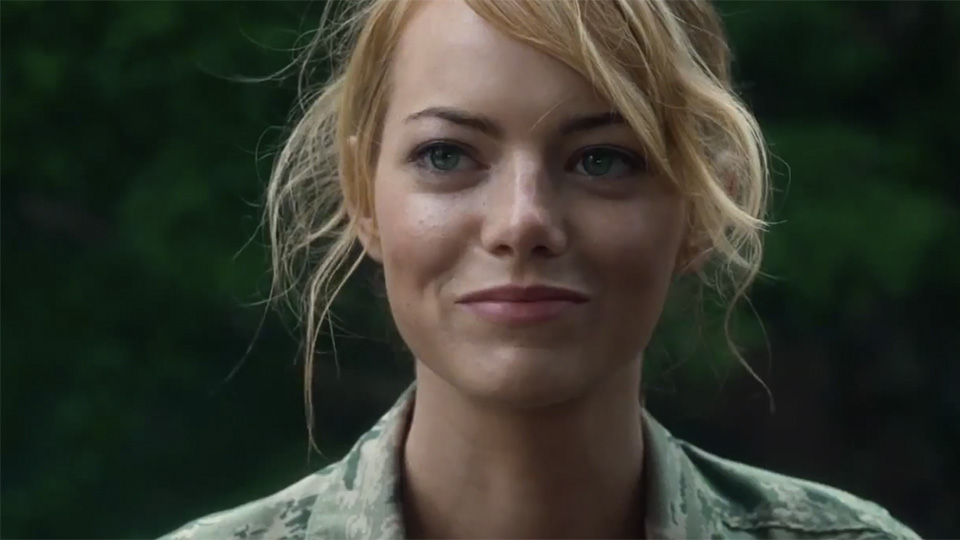 Emma Stone is smiling in an army uniform.