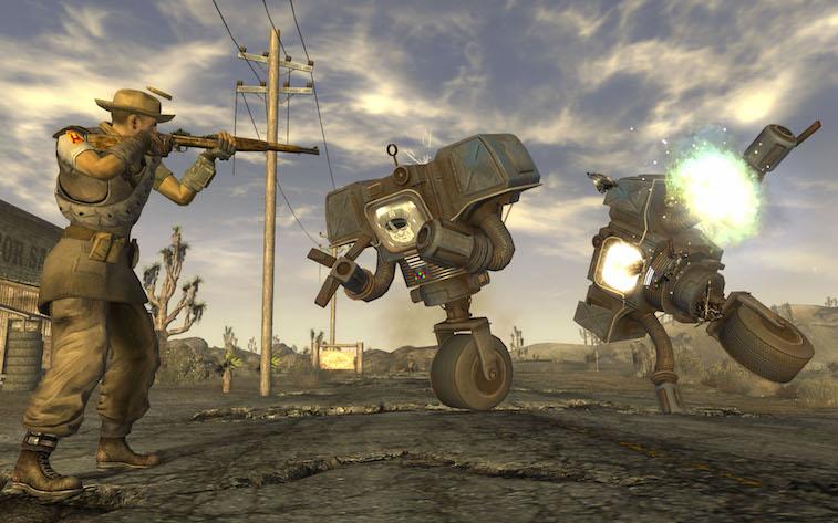 A man in a cowboy hat shoots at robots