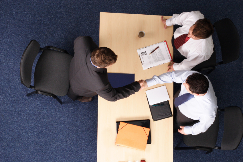 Employee in a meeting with bosses
