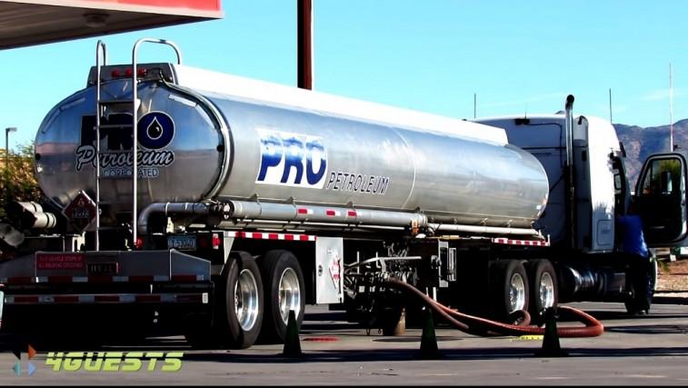 Tanker truck filling up at gas station