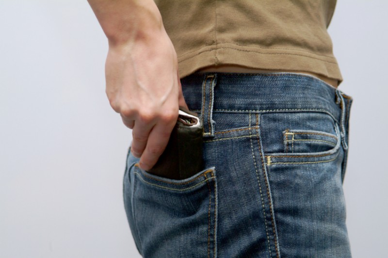 man reaching for wallet