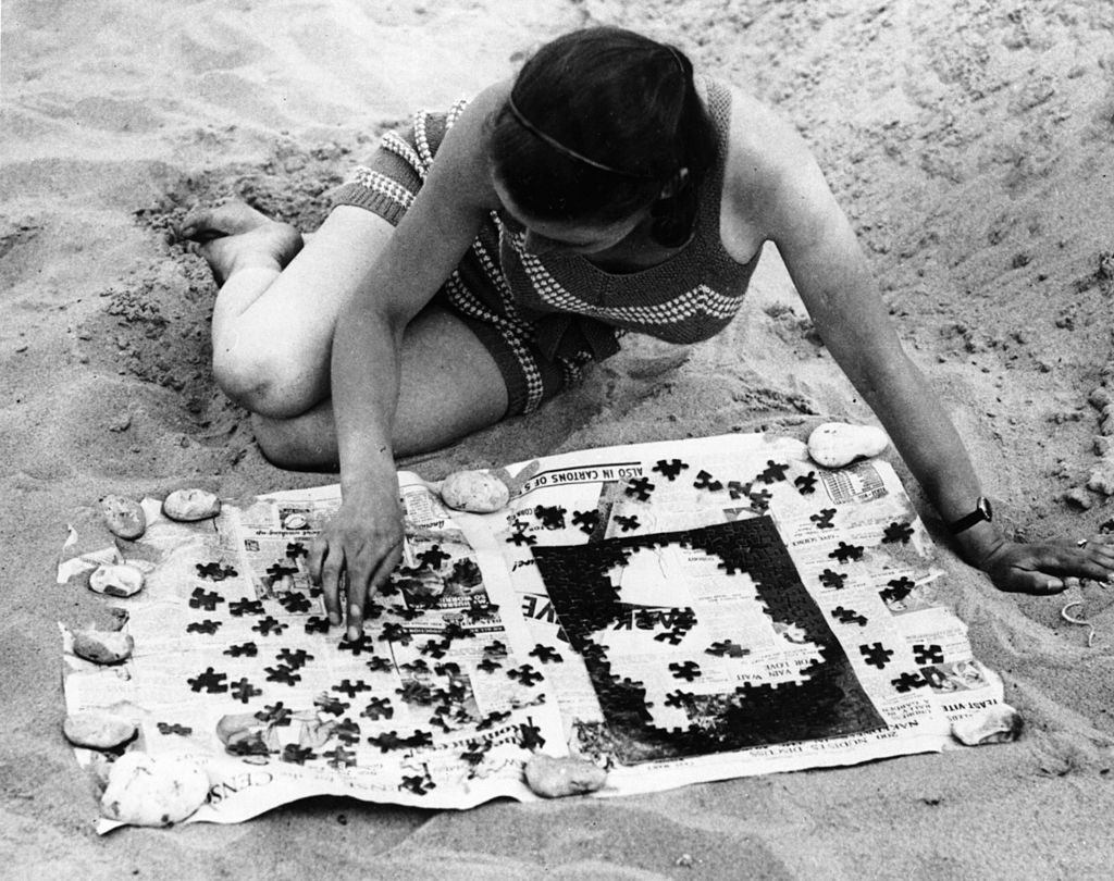 woman solving a jigsaw puzzle