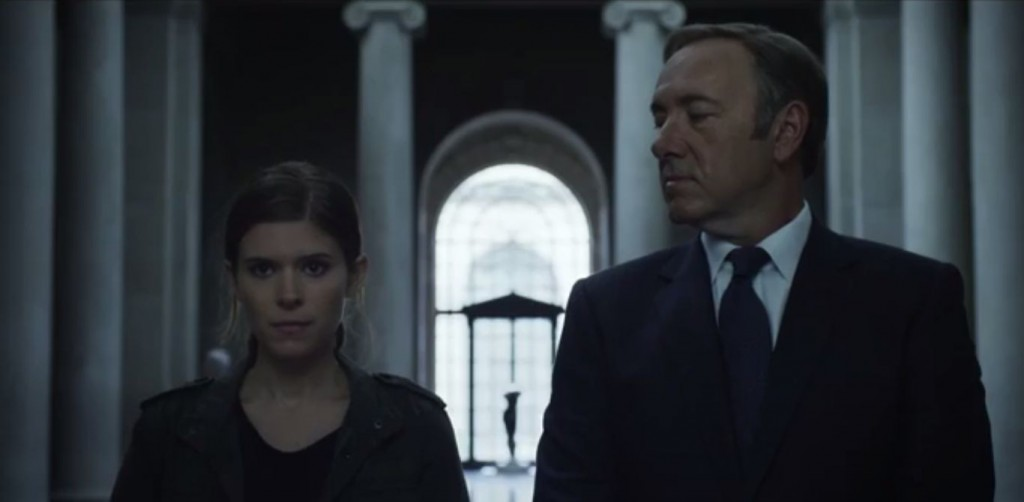 Frank Underwood and Zoe Barnes stand next to each other in House of Cards