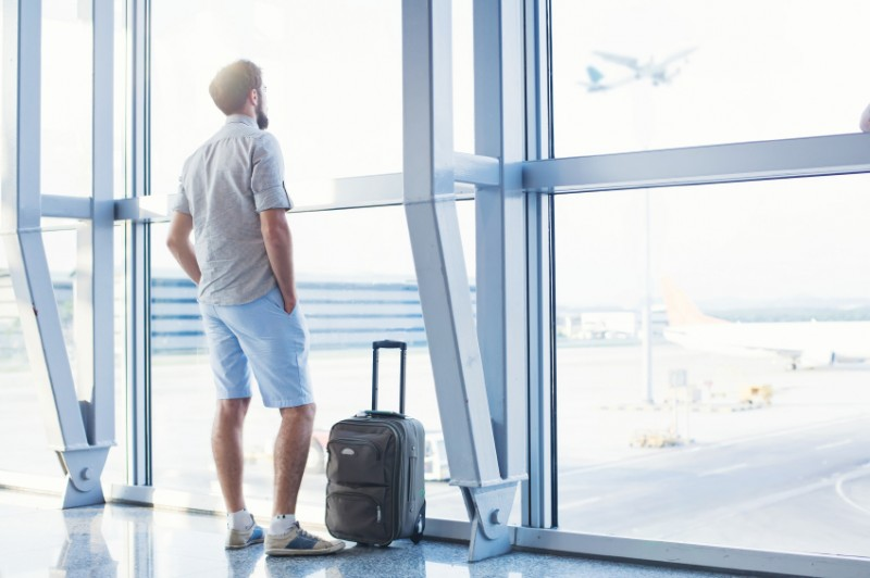 man waiting for his flight