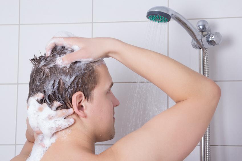a man washing his hair
