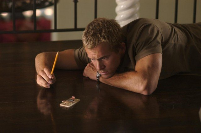 Ryan Reynolds lying on the floor.