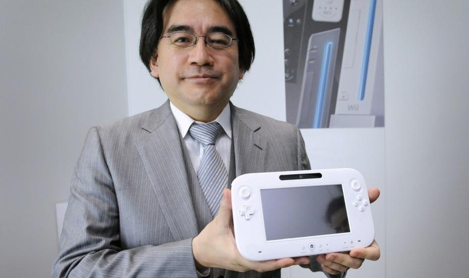 Satoru Iwata holds the Wii U
