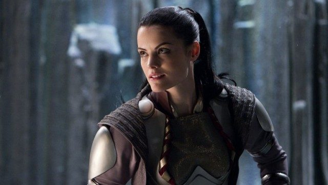 Jaime Alexander looks to her right and smiles, wearing a suit of armor