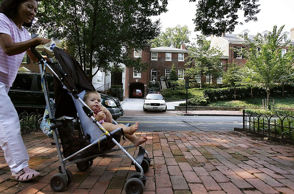 A woman walks with a baby in Washington, D.C.