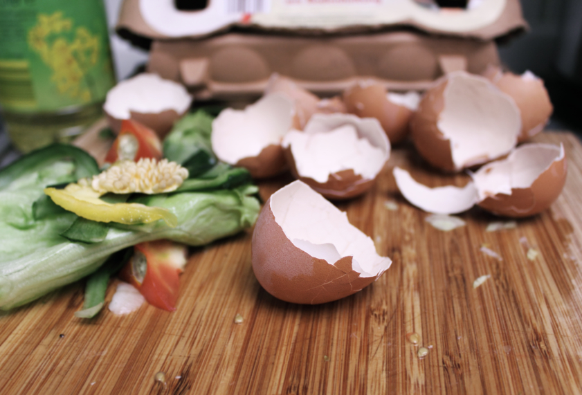 cracked egg shells and veggies