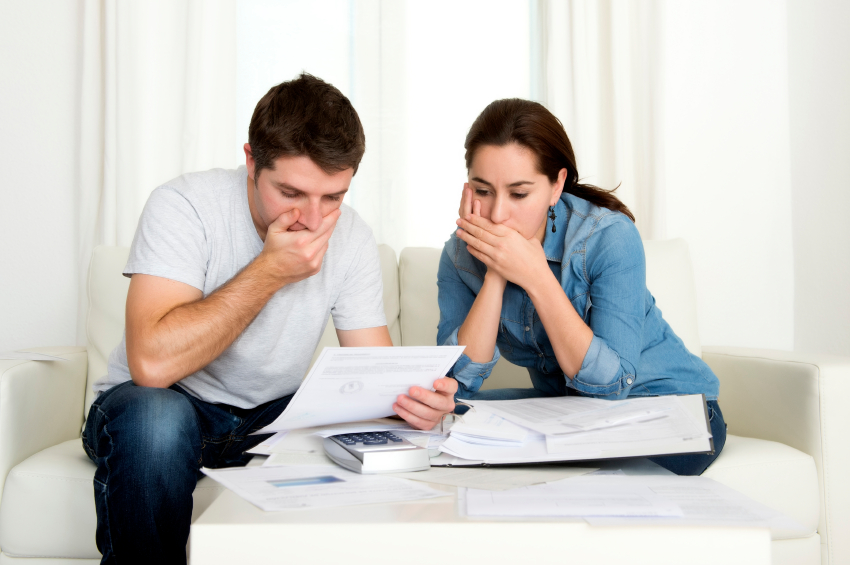 young couple looking at bills