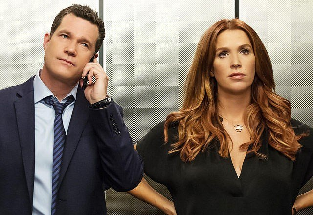Poppy Montgomery stands in an elevator in a scene from Unforgettable