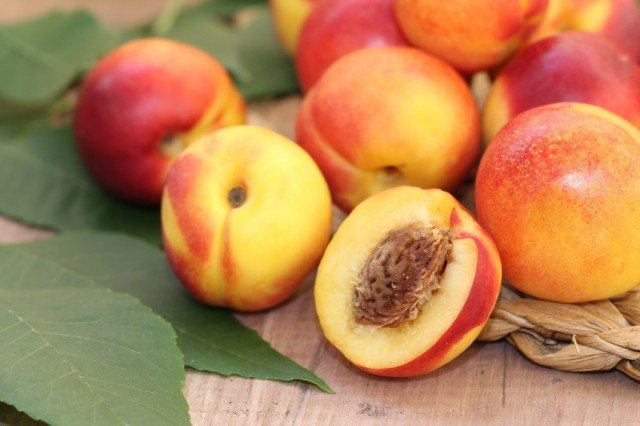 Nectarines on a wooden table.