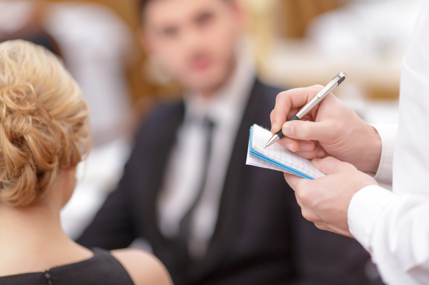 man and woman at job interview in a restaurant