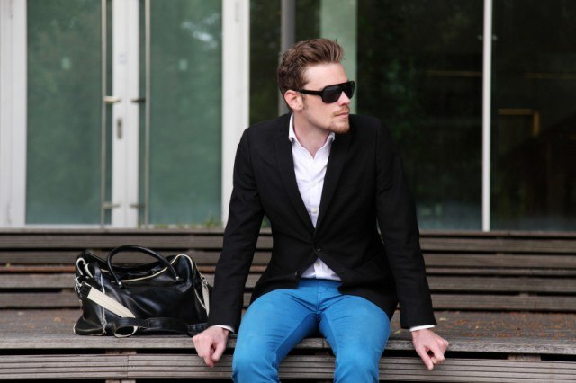 Man with sunglasses sitting on a bench