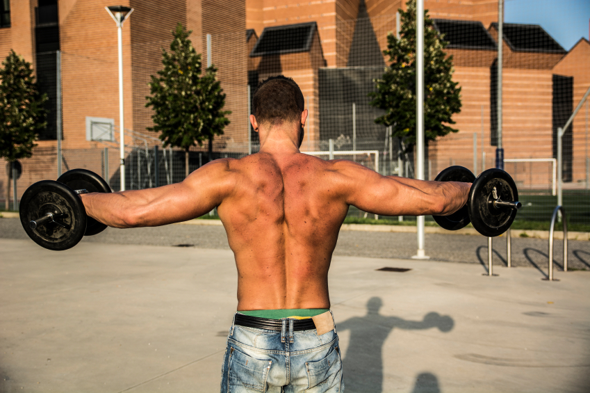strong man doing lateral raises