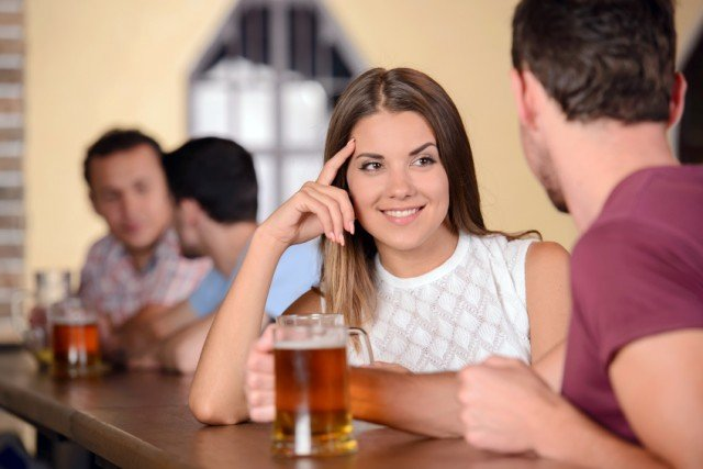 Man and woman drinking at a bar together